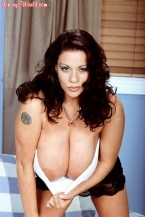 Linsey dawn mckenzie - linsey to die for. Linsey To Die For Of all the tops that Linsey has worn, there is perhaps none more dangerous for unexpected revelation than the simple, yet unappreciated, tube top. Yes, there is always the potential for Linsey to pop out of a tight halter top, but the tube top is the one piece of clothing that Linsey runs the risk of popping out of either the top or bottom, and possibly both at the same time.The editor of Glamour Girls Then and Now (GGTAN.com), Steve Sullivan, informs LinseysWorld that: Thanks to Linsey's hot new layout in the September 2004 SCORE, she'll be zooming right up the Glamour Girls' Hot 100 rankings list.* Linsey has racked up a delicious 139 weeks in the Hot 100 since the survey began in December 1999, more than any other figure model other than Pamela Anderson, Victoria Silvstedt, Victoria Zdrok, and Veronika Zemanova. She is, without question, one of the all-time greats. Linsey, keep up the charming work.*Glamour girls earn credit in the GGTAN Hot List for each weekly chart in the following categories: movies, magazines, TV, Internet, music, home video, sports, beauty & sex appeal, and miscellaneous entertainment venues such as stage or radio.See More of Linsey Dawn McKenzie at LINSEYSWORLD.COM!