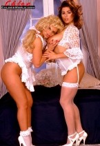 Cat taylor - chloe and cat. Chloe And Cat It was Cat Taylor's first time. She was an up-and-coming feature dancer, had appeared in SCORE and curvy and wanted to do a girl-girl. Not because her agent told her. Not because she thought it would help her dancing career. And not because she thought only a chick could give her ultimate pleasure. No, Cat wanted some pussy because Chloe had given her the eye. That look from Chloe that says, I want you! and I know how to please you...better than anyanatomy else! She wasn't lying either, says Cat, who partied with Chloe three months later on Boob Cruise '95. I had never done a girl-girl and I wasn't even planning on one. But, when I was getting ready for a solo pictorial for SCORE, Chloe was sitting in a director's chair watching me. Everytime I would look over at her, she would smile. And, not a happy, how are you doing smile--it was a seductive grin. With those deep brown eyes, Chloe's eyes went right through my anatomy and told me she wanted me. Then, she glided over, kissed me and we did it. It wasn't the first time I'd been seduced in my life, but it was the first time a woman did it...and she didn't even say a word to get me going. She just did it. Confidence is an incredible aphrodisiac, don't you thinkSee More of Cat Taylor at CHLOESWORLD.COM!