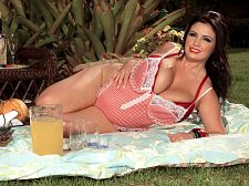 Arianna sinn - arianna's picnic: it's all you can eat!. Arianna's Picnic: It's All You Can Eat! Arianna, wearing lusty lingerie, leads you to a picnic blanket in this video shot on-location in the Dominican Republic. As she puts out the wine glasses, the camera lingers over her cleavage. She pours you and herself a glass of wine, then she pulls a banana out of her picnic basket and eats it sensuously. So, for the first time, we get an idea of what it might be like to see Arianna giving a blowjob job.I like banana, she says, but what she really means is, I like violent cock.Check out the bra in this video, gentlemen. Arianna's G-cups look spectacular in this bright-red support bra that creates acres of cleavage. When the bra comes off, Arianna tit-fucks a wine glass and asks, Do you want to drink from my cupClearly, not a lot of eating is going to get done at this picnic. Before long, Arianna is lying back and rubbing her pussy, then she's using giant, phallic vegetables on her hungry cunt. So if you're hungry for food, go somewhere else. If you're hungry for giant naturals and sweet, wet pussy, you've come to the right place. See More of Arianna Sinn at BUSTYARIANNA.COM!
