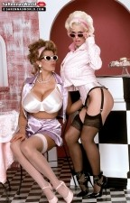 Sarenna lee - sarenna and nikki. SaRenna And Nikki  Nikki Knockers, much adored by many fans and striptease aficionados, and now retired, hangs with Miss Lee for this retro-debutante pictorial photographed in the summer of 1995 at the SCORE studio of John Graham, Britain's leading producer of mega-breasted photo shoots and videos. For buxotic behavior, it didn't get better than this bumper-to-bumper event. A perfectly-suited pair, SaRenna and Nikki often crossed paths during their individual travels on the strip club circuit in the USA. There was a large deal of mutual respect for each other and they enjoyed the brief time they posed together in London. Nikki towered over the diminutive SaRenna, but large shoes have a elegant way of equalizing this kind of situation. See More of SaRenna Lee at SARENNASWORLD.COM!