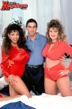 Angelique and friends. Whoever said that three's a crowd never saw this photo set. And Jack Tripper never had roommates like Angelique and Gabi, a curvy magazine model. When Angelique's bosom buddy drops by for a visit with a friend, well-known SCORE stickman Marino, it's share-and-share-alike! Soon breasts, lips, and a stiff penish are set into motion. Every imaginable combination is put in place, in a KAMA SUTRA of positions. It's hot and sweaty! A boob-bonanza of thrills which will give you spills. This is the mother-lode of photo sets, so if you miss it don't come whining to us!See More of Angelique at BUSTYANGELIQUE.COM!