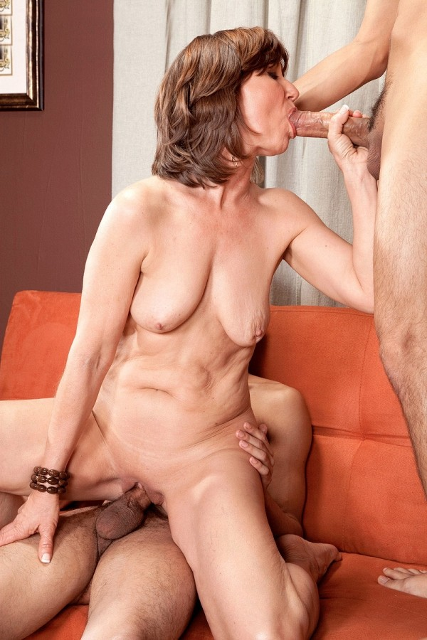 Horny granny makes the most of three young cocks 4