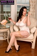 White out!. White Out! Angela is all decked out in a glamorous bustier and girdle and with what we call M'Lady shoes on her stockinged feet. A glass of vino and a cigarette stuck in a rich dame's holder complete the image of sophistication and elegance.  Of course, by the end of the pictorial, she's spreading her kitty and bum and have sex herself with a great dildo.  At times I'll look at your magazines and I think about how pleasant it is when the girls are on their own and looking glamorous and leaving some mystery about themselves, Angela said. But then I realize that this is what the guys have wanted all along. They just couldn't have it because of society and laws. Now that I can give it to them, I'm going to give them everything I have.  These photos were shot at our beach house in Eleuthera, the Bahamas during Big-Boob Paradise week. Angela was truly in paradise. See More of Angela White at BIGTITANGELAWHITE.COM!