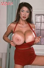 Asian bra busters. Asian Bra Busters The sexual allure and charm of the Asian woman is powerful and impressive. Minka is the ultimate Asian fantasy woman for tit-man. Most men don't seem to really care about my costumes, said Minka. They care about my tits and my nipples. They've never seen such voluminous nipples their entire lives And they're pink. Very voluminous. Very sensitive! Even so, many do want to see Minka wear certain kinds of clothing. Above all, they have to be skimpy and horny including her high heels which Minka almost always wears in her shoots. Many are partial to swimsuits and short dresses. My bust is so voluminous, I have to wear a bra, said Minka. But I love when the men look. They look at my tits, and then maybe they look at my face. Some men look at my legs. See More of Minka at MEGATITSMINKA.COM!