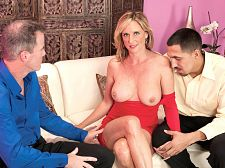 Wife, hubby and the guy he brought home from work. Wife, hubby and the guy he brought home from work It's Bring Your Employee Home For Dinner Night at the West household, but Jodi West hasn't prepared anything for dinner. What she has done, however, is dress up her tight, horny 46-year-old anatomy in a short, revealing red dress (paired with matching fuck-me pumps)  Hi, honey, we're home, Mr. West, Jodi's real-life husband, says. I brought our newest sales associate, Juanm with me. Juan has been tearing everything up at work.  Juan is about to tear everything up at the West household, too, because when Mr. West decides they oughta eat in tonight, Juan knows exactly what he wants to eat. He can't believe his lovely fortune. He can't believe he has such a voluminous boss who offers his wife's mouth and cunt as part of the bonus plan.  Of course, like most bosses, Mr. West doesn't give without making sure he's getting something in return, so before long, Mr. West is eating his wife's cunt while she suc Juan's cock. And then they're taking turns filling Jodi's MILF mouth and hot cunt.  In the end, Juan cums on her face, Mr. West cums in his wife's cunt and we get to see her play with the spunk that's dripping out of her cunt. That's our bonus. See More of Jodi West at YOURWIFEMYMEAT.COM!