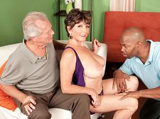 Bea, lucas and the cuckolded hubby. Bea, Lucas and the cuckolded hubby Bea Cummins, who was 67 when this scene was shot, once told us, I always loved sex. Just not with my first husband. He never did anything to satisfy me. I don't think he even knew if I ever had an orgasm. He didn't care. And forget about dressing sexy. I wore what he wanted me to wear. She was trapped in an unhappy marriage. Not anymore.  With my second husband, I finally have the freedom to enjoy sex, she said. I'm surprised by how open I am and how much freedom I have and how free I feel. The orgasms have gotten more intense because I'm not self-conscious anymore.  As an example of how much freedom Bea has with her second husband, we offer you this scene: Bea's real-life husband is sitting at home, reading the newspaper, when Bea returns from a shopping trip. And what did she get at the mall Lucas Stone  And now, Bea is going to get down on her knees and blow Lucas's big, black cock. And she's going to get on the couch and get make love by Lucas in her first interracial scene. And what is Bea's hubby going to do while all of this is happening Well, after he gets his bearings, he's going to sit down on the couch next to Bea (check out how she holds onto her husband while Lucas slams her pussy), then he's going to make the most of his situation by getting his cock out. And then Bea, lovely wife that she is, is going to blow her hubby's cock while Lucas fucks her.  Freedom. It's just another word for another load to lose. See More of Bea Cummins at YOURWIFEMYMEAT.COM!