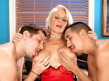 Georgette parks - georgette fucks two guys for the first time on-camera. Georgette fucks two guys for the first time on-camera When this scene opens, 65-year-old Georgette Parks looks very libidinous but classy. She's wearing red lingerie and stockings. Even when she's talking about getting fuck by two guys on-camera for the first time, she still has that air of class.But then the camera pans down. Hey, Georgette isn't wearing any panties! Her shaved cunt is right there for all the world to see! And then we remember: Georgette is a classy slut.The two guys show up, one on each side of her. I want you to fuck me, slut Georgette says. I want to get fuck so bad. And I want to gulp both of you.Georgette kneels between them and gulps one while jacking the other. Then she lies back and takes turns gulping one guy while the other fingers her cunt. When the make love starts, there isn't a moment when Georgette's mouth and cunt aren't simultaneously stuffed. Okay, there are a few moments: when they're changing positions.Question: How much cumshot can Georgette coax out of two cocks at the same time You'll have to watch the video to find out.I love cock, Georgette said, and the more the merrier!See More of Georgette Parks at MILFTHREESOMES.COM!