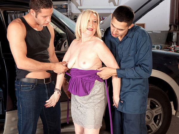 60Plus MILF gets fucked by two guys on the garage floor