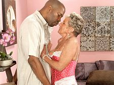Oldest gilf ever gets big, black cock. Oldest GILF ever gets big, black penish Sandra Ann is an amazing woman. She's 75 and our oldest GILF ever. She's into sex in public places. She once have sexual intercourse a man while he was driving a motor home. She sat on his lap, and he looked over her shoulder as she grinded into his penish. And while her old bitty friends are sitting at home on the couch watching TV, Sandra Ann is doing her first porn scene. They think she's crazy. We think she's horny.  I'm always looking, she said. And sucking. And fucking.  We spoke to Lucas, the stud in this scene, after the fucking, and he said Sandra Ann gave the best head he's ever had.  How many women have deep-throated you we asked him.  One, Lucas said. Her.  And that means Sandra Ann isn't just the oldest. She's the best.See More of Sandra Ann at SILVERSLUTS.COM!