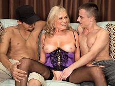 A threesome for mom. A threesome for Mom Bethany James, a 64-year-old tall drink of water from Ohio, plays out one of our favorite fantasies: exciting MILF have sexual intercourses her daughter's ex-boyfriend. Actually, in this case, it's her daughter's ex-boyfriends because Bethany has her way with two guys. She suc them. They have sexual intercourse her. And when they're done, they shoot their loads all over Bethany's face. have sex the daughter! Mom's much hotter.  There's a lot to love about Bethany. For starters, her nipples, which are always erect. Then there's her bedroom voice. You could get rough just by listening to her speak. And her height. She's 5'11.  Men have always been attracted to me, and I've always been attracted to them, Bethany said. I love men. I've never had sex with a woman and I never want to because I love men so much. I love the things they'll do to get into a woman's pants.  For example A guy once came up to me in a club and said, 'Do your legs go all the way up to there' I laughed, then I said to him, 'Would you like to find out'  The two guys in this scene find out.See More of Bethany James at IBONEDYOURMOM.COM!