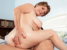 69-year-old bea cummins fucks 25-year-old johnny. 69-year-old Bea Cummins have sexual intercourses 25-year-old Johnny Bea Cummins is lying in bed, looking libidinous in lingerie and feeling very horny. She's rubbing her cunt and decides, Hey, why do I have to do this all by myself My hubby is right next to me!  Bea nudges him. C'mon, wake up. I am so horny.  Hubby doesn't even open his eyes. How many times can he have sexual intercourse her in one day The guy needs his rest. But Bea needs some penish.  Meanwhile, down the hall, Johnny, Bea's son's best friend, wakes up to go to the bathroom and hears a noise orgasm from the marital bedroom. He goes off to investigate and...holy shit, Mrs. Cummins is playing with herself! And then she sees him and motions to him to come over. Right there By the bed With Mr. Cummins sleeping You're damn right!  Before Johnny knows it, he's got his rock-hard penish in Mrs. Cummins mouth, and when Mr. Cummins stirs, they head for the guest bedroom, where Mrs. Cummins can have sexual intercourse her son's best friend and her son's best friend can have sexual intercourse his friend's mom. And since Mrs. Cummins is 69, it's safe to creampie her cunt. Don't have to worry about getting her pregnant, not like those young girls who don't know how to have sexual intercourse and are afraid of icky cum.  Not Bea. She loves cum. And she really loved have sexual intercourseing a guy who's young enough to be her grandson. See More of Bea Cummins at GRANNYLOVESYOUNGCOCK.COM!