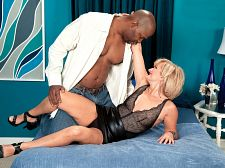 Polish milf's first black cock, first booty. Polish MILF's first black dick, first booty This is the first booty scene for 55-year-old divorcee Ellie Anderson, and it starts out with a brief interview.  They told me you have a little surprise for me, Lucas says, thinking this is merely Ellie's first interracial scene and nothing more.  Yes, I do, Ellie says.  Ellie tells him that she's from Poland. Now she lives in Portland, Oregon.  Do you like surprises Ellie asks.  We like surprises that are encased in tight, short leather skirts.  Finally, Lucas removes Ellie's skirt and discovers her surprise...in her ass! It's a arse plug! Ellie's analy is in training!  Did you put that in there for me Lucas asks.  Yes. Do you like it Ellie says, a question that needs no answering.  So, while the arse-plug is secured firmly in her analy, Ellie dick sucking dick then she gets her pussy fucked and then the arse plug comes out and Lucas's dick goes in.  Surprise! Everyone cums! See More of Ellie Anderson at GRANNYLOVESBBC.COM!