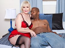 Lola lee's darkest fantasies come true. Lola Lee's darkest fantasies come true Granny Lola Lee, 66, is in bed, wearing red lingerie and stockings and rubbing herself.  I'm so lascivious tonight, she says. I'm so lonely.  What Lola Lee lonely How can that be  I wish I had a big, black penish to take care of me, she says. Her legs are spread, her vagina is ready, but there's no guy in the room. She falls asleep. Cut to Wizard of Oz music (no, not really). She fantasizes about a guy showing up. It's Lucas with his big, black penish, and Lola gets right to work on it.  Oh, this is wonderful, she says as she rubs his slab of trouser meat against her face. So pretty. charming So big. Can't argue with that.  If you've seen Lola Lee, you already know why she's one of the most popular MILFs ever. If you haven't seen her, you're about to find out. Watch Lola get make love hard. Very hard. Yep, she's 66. And still making her fantasies come true.See More of Lola Lee at GRANNYLOVESBBC.COM!