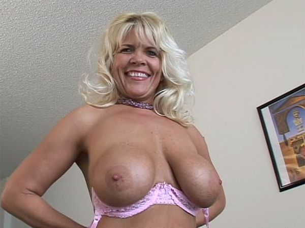 Busty blond MILF spreads wide