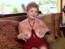 Former teacher, now busty slut. Former teacher, now busty slut What's a retired school teacher doing at YourMomsGotBigTits.com  Showing off my big, juicy tits, said Valerie, who was 67 when this was shot. Spreading my cunt so you can see what you'll get to have sex if you're ever lucky enough to run into me.  How does a school teacher turn into a cunt-spreading nympho who have sexs her former students  The cunt spreading is new, but the nympho was always there, Valerie said, laughing. My sister's very libidinous, too, so I guess it must be in the genes. Sometimes when one of my former students is really good, I'll pass him along to her.  In this video, we see this busty redhead showing off her acting ability. Valerie is playing the part of a libidinous wife (that part is accurate) who's sitting around all day waiting for her husband to come home. That's where the fiction comes in. In real life, Valerie would just go out and find somebody else to have sex. Forget the hubby. But here...well, there's nothing wrong with a little bit of fantasy, and you're going to enjoy watching Valerie get off.See More of Valerie at YOURMOMSGOTBIGTITS.COM!