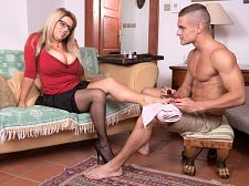Veronika - great breasts & libidinous feet. Voluminous breasts & libidinous Feet Veronika waits for Max, a guy who's going to paint her toenails. She adjusts her voluminous natural tits in her low-cut blouse because there's going to be a lot more than nail polishing going on in a few seconds. Max is about to be converted from a foot man to a tit man and Veronika has the assets to make it happen. Max is going to be converted but in exchange, he gets to play with Veronika's head-crushing jugs of joy. The toenail polishing comes to an abrupt end when Veronika takes his hands and puts them on her considerable hooters. Ever the aggressor, Veronika needs some cock action, not her toes painted. Popping her treasures out of her top, Veronika tells him to cock sucking and lick 'em. Veronika takes Max's boner out and sticks it in her mouth, licking it like a popsicle and dripping spit on it. The next stop for his cock is between Veronika's breasts. She holds them together to create a tit-pussy for him. Veronika takes off her eyeglasses and turns around, supporting her arms on the back of the couch. Max pulls her panties to the side and shoves his cock into her waiting pussy-hole from behind. Getting her totally naked on her back, he spreads her legs and plows into her again, her natural tits shaking and wobbling. Max is now a tit man. See More of Veronika at SCORELAND.COM!