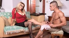 Veronika - large breasts & lascivious feet. Considerable boobs & excited Feet Veronika waits for Max, a guy who's going to paint her toenails. She adjusts her considerable boobs in her low-cut blouse because there's going to be a lot more than nail polishing going on in a few seconds. Max is about to be converted from a foot man to a tit man and Veronika has the assets to make it happen. Max is going to be converted but in exchange, he gets to play with Veronika's head-crushing jugs of joy. The toenail polishing comes to an abrupt end when Veronika takes his hands and puts them on her considerable hooters. Ever the aggressor, Veronika needs some cock action, not her toes painted. Popping her treasures out of her top, Veronika tells him to blow and lick 'em. Veronika takes Max's boner out and sticks it in her mouth, licking it like a popsicle and dripping spit on it. The next stop for his cock is between Veronika's breasts. She holds them together to create a tit-pussy for him. Veronika takes off her eyeglasses and turns around, supporting her arms on the back of the couch. Max pulls her panties to the side and shoves his cock into her waiting pussy-hole from behind. Getting her totally naked on her back, he spreads her legs and plows into her again, her boobs shaking and wobbling. Max is now a tit man. See More of Veronika at PORNMEGALOAD.COM!