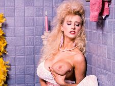 Wendy whoppers - the big '90s superstar. The voluminous '90s Superstar In the early days of SCORE (beginning in 1992), the great bust modeling and dancing world was dominated by the mega-boobed girls. There were dozens of 'em with super-huge breasts and Wendy Whoppers was one of the most well-known of the group. Back then, clubs around the USA and Canada were booking them as features for the week and the club circuit was hectic. The girls were packing these clubs out every night.SCORE was filming them constantly and the roster included Lisa Lipps, curvy Dusty, Lisa Chest, Jessica Juggs, Niki Knockers, Minka, Angelique and many more.Physically, Whoppers is a gorgeous girl with a fragile look that belied her inner toughness. At 5'1 and a mere 98 pounds, her measurements of 80HHH-21-34 (at the height of her dancing and porn career) were astounding. The audience would go nuts when she exposed her elegant breasts on stage. Although she made more money dancing than from her porn video fees, the public exposure from the adult movies helped to increase her popularity and name recognition. Appearing in every great boob magazine in the world fueled the fires.At porno industry expos, Wendy caused pandemonium...just by being Wendy Whoppers. I was there and I saw it. I wrote in SCORE's Boob Beat column for the July '94 edition (which featured covergirl Wendy in a solo pictorial), Photographers have a field day at the Consumer Electronics Show and this year was no exception. The ultra-dynamic duo of Lisa Lipps and Wendy Whoppers made explosive entrances and exits, worthy of the Cannes Film Festival, and drew the greatgest mobs of frenzied shutterbugs I've ever seen at CES. Back in 1994, one of the more widespread publicity gimmicks in the great bust world was the planned wedding of Lisa and Wendy in Las Vegas. At the time, they were living together, often worked together and were close friends, so it made for inviting copy and talk. Why not Their names were usually paired up anyway in the minds of the super-bazooka loving public: Lisa Lipps and Wendy Whoppers. Later they would go their separate ways, with Lisa remaining in Vegas, while Wendy would move to Ohio, then ultimately relocate to Florida.Boob men were jolted by a comeback pictorial in September '97 SCORE of Wendy with much smaller boobs, black hair and tattoos. The effect is startling at first for those used to her trademark huge breasts and blonde bangs. The new Wendy was sexy. Just in an extremely different way.With her feature dancing and modeling career behind her, the new (now blonde again) Wendy entered the equally new world of the Internet. She taught herself web design and lives a life that's a million miles away from the mobs of excited fans who once encircled her at the CES and Video Software Dealers Association conventions and in adult stores throughout America.See More of Wendy Whoppers at SCORELAND2.COM!