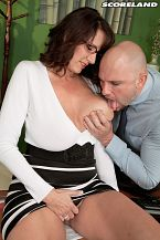 Secretary's lunch hour. Secretary's Lunch Hour Our returning big-boobed MILF of the Month Cassie Cougar was ready for the secretary sex challenge when she paired off with boss JMac and turned lunch hour into a happy ending on his desk.  When I was shooting the stills with JMac, I guess we were doing some standing doggie thing, and he had my leg on his shoulder, Cassie said. I didn't even know I could bend that way!  Cassie's divorced and is a real mom, not a fake porn MILF. She used to actually be a secretary. She became a bartender, then a stripper, then a public access TV comedy show co-host and eventually returned to the secretarial pool. At 5'10'', 40-32-42 and stretching a 36G cup, Cassie always cuts an impressive silhouette.   I like to be teased for a while, make me beg for cock, don't let me have it, then surprise me with a nice pounding.  That's what bosses are for. See More of Cassie Cougar at SCORELAND.COM!