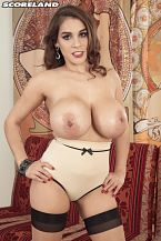 Mischel lee - bullet bra babe. Bullet Bra Babe Some men are more interested in my hair than in my tits, said Mischel Lee, who's got her now-bigger natural tits encased in a bullet bra, the pointed bra worn to create sweater missiles in the 1950s.I attract a lot of men because of my natural tits, but when they see me not wearing clothes, some men spend more time on my vagina. That's nice because I cumshot best when my vagina is licked. I had my vagina lips pierced for my pleasure. The men I meet love the jewelry and my hair almost as much as they love my big tits. Now that Mischel has bigger tits than when she first appeared at SCORELAND, is her sex life sexierI think so. My nipples feel more sensitive. I like to look at them in my mirror more than before. I am more aware of my tits now so I think because of this, and because they are bigger, I get more people looking at them. I think guys spend more time cock sucking and licking my tits. They play with them more. My boyfriends can't keep their hands off them. This makes sex better.See More of Mischel Lee at SCORELAND.COM!