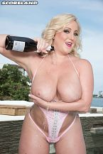 Miami nice. Miami good Several of the pictures in this pictorial of Holly Wood on-location could be ads for a south Florida tourist board promoting a Come to Miami campaign.  California girl Holly talked about her afternoon by the water.  SCORELAND: Tell us your thoughts about this shoot. Was this what you envisioned in sunny Florida  Holly: The champagne shoot had to be my favorite of all the scenes that I've done! It really was Me and so real! Pool, champagne, good scenery, and having fun! Can it get any better   SCORELAND: When you had some free time, what did you do in South Beach  Holly: I went to Ocean Drive, of course! My hangout spot is The Palace. It was so much fun to watch the live show, say hi to friends I made on my first trip and then walk across the street at sunset to play in the ocean and take in the amazing views!  SCORELAND: You went to the nude beach Haulover. You must have gotten really checked out.  Holly: Jax Slayher took me to Haulover beach right before I had to head to Miami International Airport to go home. I actually had no idea a nude beach was so close! If I had known, I would have gone every night! I love being naked and I love the ocean. It was a perfect combo! People probably thought I was crazy because I basically stripped down as I ran and jumped into the water. Hilarious! See More of Holly Wood at SCORELAND.COM!