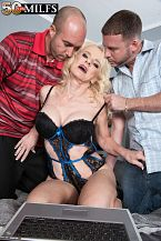 Bnurse cammille gets ass-fucked by two guys/b. A three-way for Cammille Austin in which she gets butthole-fucked by both guys We have to admit, that's not unusual. This is a woman who had a gang bang with eight big, black cocks on her wedding night while her husband watched. Of course, they all took turns on her butthole. And when the guys were done, her hubby, who had been filming the action, got some sloppy seconds. Or sloppy ninths.  But it's always special when a blond, beautiful, big-titted 58-year-old MILF has a three-way on-camera. This is Cammille's second three-way at 50PlusMILFs.com, and watching her never gets old.  We asked Cammille if she likes it rough or gentle, and she said, It varies. It depends on my mood. Sometimes I really like it slow and erotic to where I can really connect with the person. Other times, I like it fast, heavy and rough. I love having my butthole slapped and my nipples pinched. I don't want it too heavy where you leave marks, but I love having my butthole slapped. I'm finding out that I'm up for anything!  Cammille lives in Arkansas, a relatively conservative part of the United States.  I work in health care, she said. My husband is a surgeon, so mainly I'm seen in scrubs. We once had sex in the surgeons' locker room. We could've gotten caught and that made it very exciting, but it was nothing compared to this.  This, meaning getting butthole-fucked by two total strangers who ejaculate all over her nice face. As we said, watching her never gets old. See More of Cammille Austin at 50PLUSMILFS.COM!