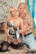 Cock for coco. Penish for Coco Meet Coco de Marq, a 52-year-old divorcee from Prague. Today, this lascivious blonde newcomer is going to:  1. blowjob cock. 2. blowjob balls. 3. Have her vagina eaten. 4. Get fuck in several positions, including missionary, doggy, cowgirl and reverse-cowgirl. 5. Open her mouth for cumshot then let the white sauce drip down her chin and onto her lovely tits.  She's wearing lascivious stockings and a garter just for us, and, by the way, when she's riding the cock, she spreads her ass so we can see her anus. Will we see that anus get fuck Who knows, but we can hope.  We asked Coco if she likes sports, and she said, I'm not into sports. I'm into sex.  That's fine by us.  She likes to wear short dresses that show off her lovely legs. She should wear tight jeans that show off her lovely ass, too. She says the people she knows wouldn't be surprised to see her here. She isn't a swinger or a nudist, and when we asked her what she finds lascivious, she said...  When a guy has a shaved cock.  She probably means the balls and the area around the cock, so be careful, men.  She likes younger men. She once had her vagina eaten under the table in a fancy restaurant. Sounds like dessert. See More of Coco de Marq at 50PLUSMILFS.COM!