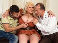 2 blokes for sammy. 2 Blokes For Sammy These two gents have nothing to do but sit on the couch and yak away about nothing. Well, Samantha Sanders is here to change that situation. She interrupts them to announce that she's ready to share her national treasures with them and gives her world-class flesh-globes a squeeze to emphasize what she means. We think Sammy is ready for some action!  Sitting between the two blokes, Sammy and her large 34JJ twin peaks are now the new objects of their attention. One look and they are on her hook. Never underestimate the power of breasts. There's enough for two, says Sammy. In fact, there's more than enough for two! The guys take her boobs out of her dress and start suc her nipples, something she loves.   George uses a free hand to fondle Sammy's pussy, then leaves her nip to head south and eat her out while Richy drops trou to rub his penish on her jugs. There's enough of this whole lotta woman to share and the guys and their lady friend spend a appealing afternoon have sexual intercourse their brains out in as many positions as they can think of.   I love oral sex and massive have sexual intercourse, Sammy tells us, and this British bra-killer gets plenty of that in this torrid three-way. What a randy woman! See More of Samantha Sanders at XLGIRLS.COM!