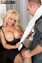 The shrink who makes things bigger. The shrink who makes things voluminousger The epitome of the classic MILF with her blond hair and voluminous breasts, 54-year-old Bella Dea is a shrink in her first scene at 50PlusMILFs.com. Her patient is Jimmy, who says he's been feeling unfulfilled sexually. Turns out Jimmy has been dating young girls who want a father figure rather than mature women who just want his cock. Bella solves his problem by suc his cock and fuck him. Jimmy unloads his frustration into her open mouth. Patient cured.  By the way, what kind of psychiatrist wears a low-cut blouse with her breasts popping out and fishnet stockings Our kind!  Bella is from Southern California. No surprise there. She's divorced and has two college-age daughters. She's 5'5, 106 pounds with DDD-cup breasts. When we asked her if the people she knows would be surprised to see her here, she said, My conservative friends would. My liberal friends would laugh and say, 'That sounds like something she would do!'  And she did!See More of Bella Dea at 50PLUSMILFS.COM!