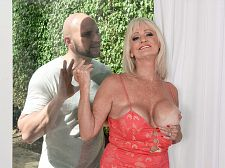 Bjmac shoots his load, leah swallows/b. JMac shoots his load, Leah swallows Leah L'Amour is 64 years old. She's a mother and a grandmother. She's also a wife, and she and her lucky husband are swingers. The story of how they became swingers is nice entertaining.  He always wanted a threesome, like a lot of guys do, and so I tried to do a birthday surprise for him and tried to get another girl to do a threesome, but back then, society wasn't quite as open to things, and I almost ended up in jail over it, Leah said.  Jail   I was calling escort sites, and I was asking them if I could hire a girl to be in a threesome with us, and they said, 'No, we don't do that.' So, to make a long story short, I didn't get it put together, but he always wanted to do this, so five years ago, he said, 'Why don't we look for a threesome again' so we started looking, which brought us to the swingers sites, and that's how we ended up getting into the swinger lifestyle.  For the record, Leah and her hubby still haven't had their threesome. But Leah has have intercourse a lot of new men--sometimes with her husband present, sometimes with him not--and now she's fuck for the second time at 60PlusMILFs.com. Actually, the fourth time, since we film our photo sets and video separately.  Here, this good, blond GILF is walking around a good house with her breasts popping out of a long, horny dress. She opens the shades and sees JMac working in the backyard.   I love those young guys, Leah says as she calls him over. She gets up against the glass and takes out her breasts, something he definitely didn't expect, and that's the signal for him to stop working and start getting to work. Before JMac knows it, he's getting his dick expertly sucked by a super-horny GILF, then he's fuck her cunt every which way and cumshot in her mouth. Yeah, Leah swallows. Of course she does.  I've never had sex in front of the camera, Leah told us the first time she was here. I've had sex in front of people, but I usually don't pay attention to what they're doing. I'm more focused on what I'm doing! See More of Leah L'Amour at 60PLUSMILFS.COM!