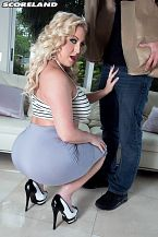 Fuck the delivery guy. Holly Wood orders a load of groceries for a party. The delivery guy turns out to be JMac who is excellent at delivering loads. JMac tends to move from job to job (tow truck operator, A/C repairman) because he winds up fuck his voluminous-boobed customers and gets laid off, in more ways than one.  Holly didn't order stud service with the groceries but she is not a girl to turn down an opportunity for some hot fun. When he sees Holly's smoking bod, voluminous tits and voluminous ass, he decides to stick around and get her all sticky.  We talked to Holly to find out if the delivery service was satisfying.  SCORELAND: What was your favorite position with JMac   Holly: Jackhammer or pile-driver was definitely new to me for filming. It allowed him to get deep and really felt amazing! JMac and I hit it off immediately! It was such a fun scene to do, really!  SCORELAND: When you are watching your scenes, what's hotter to you: you looking into the camera or not looking into the camera  Holly: It depends on the scene! Both are lascivious to me! I pay more attention to the sounds and moaning happening than where my eyes are.  SCORELAND: Would you say that doggie is the favorite fuck position for most of your guys back at the Bunny Ranch  Holly: Doggie-style is very popular with the gentlemen I see at the Bunny Ranch! Just as popular is the tit-fuck! Men really do get the best of both worlds with me!  SCORELAND: If you were to do a girl-girl or a girl-girl-boy scene in the future, who would be the SCORE Girl and stud you would want the most  Holly: Dolly Fox is a lascivious blonde who I'd love to play with! My second girl crush is Katie Thornton. She's just incredibly hot! And for the stud, Jax Slayher! I've been dying to work with him! We are actually friends in real life so I know our scene would be out of this world!  SCORELAND: Katie and Dolly don't do hardcore with men but that would be a fantasy mini-orgy. Thanks for another lascivious scene. See More of Holly Wood at SCORELAND.COM!