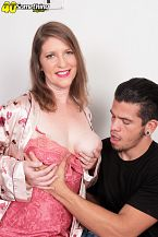 She's the typical woman-next-door this is not typical. I'm your typical woman-next-door, said Kandi Jones, a 41-year-old wife and first-timer who's not so typical in this scene. For one, she's make love on-camera for the first time. Most women do not fuck on-camera. For another, she goes very deep on Bambino's big cock. Gets it all the way down her throat and looks into the camera while she's doing so. She sucks his balls, too. Then she fucks him. Then she opens her mouth for his cum. And she does all of this while her husband of 20 years is sitting a few feet away off-camera.  Hmmmm...typical woman-next-door We don't think so.  But we'll let Kandi, who lives in South Florida, tell her story.  My husband always thought I was more appealing than I thought I was. He always encouraged me to show off a little. He would take pictures of me and we would do the at-home sex videos thing. One time we went to Vegas, and he took me to the Green Door, and we met a couple, and the second evening, I felt comfortable enough to actually have sex. Not together, but we had sex in the same room, and then the next night, we met up with them again, and she and I got together. So that was our first take on an adventurous sexual exploration. It was very horny and very hot.  We visited a couple of other sex clubs, and I found that I really like being naked and I really love when people watch me. We moved to Key West about six years ago and started spending a lot of time at the Garden of Eden. I got hit on a lot, so my husband started encouraging me to see if anyone wanted to come home with us. And we did. Brought home a few sailors. A lot of young guys.  My husband encouraged me to apply to The SCORE Group. I kind of laughed him off. I really thought there was no way you would want me, so I just let him put in the application, and then, lo and behold, I got a phone call from The SCORE Group. I've never been more excited. I really, really hope that you enjoy watching my videos. It's my first time having sex on-camera. I'm a little nervous. A lot nervous! He's a total stranger, so if you're ready, I'm ready. Here we go! See More of Kandi Jones at 40SOMETHINGMAG.COM!