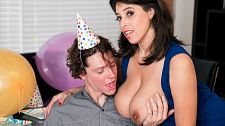 Bangin' birthday. Bangin' Birthday It's Rion's birthday and curvy sex-star Elle Flynn has decorated the place with party decorations. She carries out a cake and takes out two huge toys that men love to play with. blowjob and squeezing her fleshy natural tits makes a guy's nuts hotter than those birthday candles.   If he doesn't lay the wood to Elle, he'll need to run to the bathroom but he won't have to. Elle is his birthday present. Elle is as excited as always. She swallows his cock and takes it between her huge, natural ta-tas before spreading her legs to get her pink filled and drilled.  Once they see my natural tits, they become boob men, Elle said and that's no boast. Guys will say they like legs or bottom the best, and I will always say, 'Well, you haven't seen my natural tits.' I convert them.  I love getting fuck by a curved cock. My first SCORELAND scene was with two guys and one of them had a curved cock that really hit my spot. I like my arse tickled and I've allowed a few fingers inside my bottom but I haven't yet explored assed sex.   The birthday boy jerks in Elle's mouth after their birthday bang. She's only a spitter this way: After a guy cumshots in my mouth, I often spit his cumshot on my natural tits.See More of Elle Flynn at PORNMEGALOAD.COM!