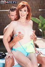 Diamond is a cock's best friend. Diamond Red, who's 64 years old, makes her worldwide hardcore debut by blows and fuck a 33-year-old's dick. That's nothing new for this mother and divorcee from Arizona, who regularly dates guys half her age.  I've been with a man as young as 33, and now I'm seeing a man who's 39, and he just loves older women, said Diamond, who's a super-slim and lustful redhead. But men are men and women are women. There's no beautiful age or bad age.  True, but there are better ages, and 64 is one of them.  Diamond is a mother of two and a grandmother of four, and when we asked her if the people she knows would be surprised to see her here, she said, Some yes and some no. I have a wide variety of friends. Some would be shocked and would never talk to me again. Others would want to know when my movie will be out so they can buy it.  One friend who wouldn't be surprised: 60Plus MILF Leah L'Amour, who sent her our way.  I love Leah. She's so full of life and she's so beautiful, but she's not only beautiful on the outside. She's beautiful on the inside, too.  One day she was telling me about what she did at 60PlusMILFs.com, and she said, 'Diamond, you would just love it! You get to walk around with hardly any clothes on and you get to blow dick! You get to fuck! And because you perform and because you're so out there, I think you'd be perfect, so you should go for it.' And everything she told me was very truthful and honest.  By performing, Leah was referring to the fact that Diamond used to dance burlesque. And now she's dancing on a young guy's dick and opening her mouth for his cum. Letting it drip onto her lovely tits, too.  This Diamond is a dick's best friend.See More of Diamond Red at 60PLUSMILFS.COM!
