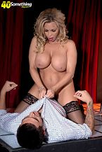 Busty MILF exotic dancer Amber Lynn offers extras