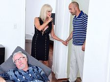 64-year-old Leah screws. Her partner watches.