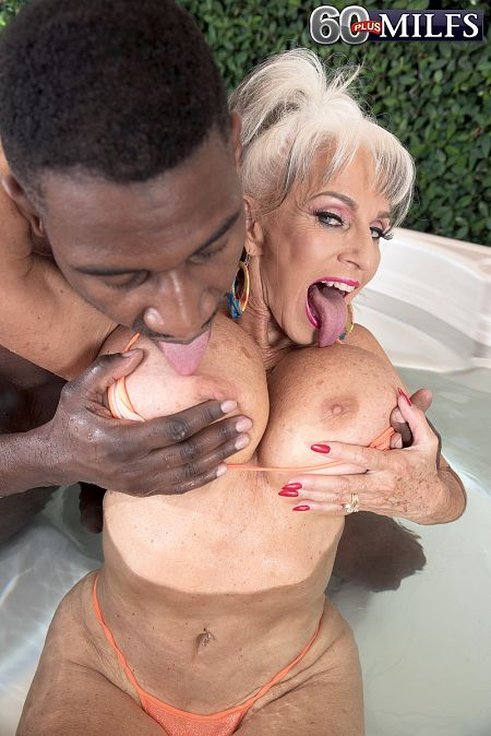 Super-stacked, super-GILF Sally fucks a big, black cock