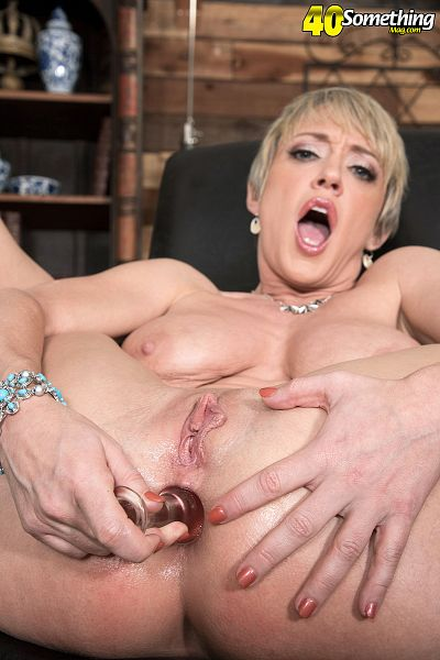 A horny old blonde slut rides a stiff black cock of steel 5
