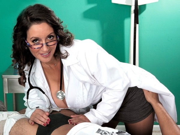 The doctor has big tits, a hairy pussy and a dick-sucking mouth